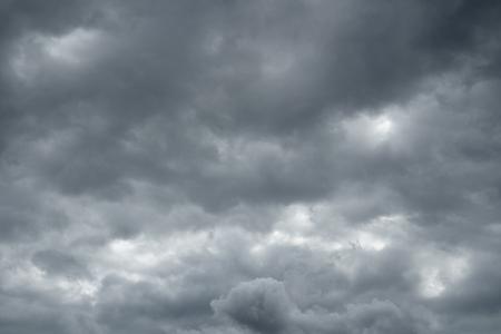 over the horizon: Storm sky, rain. Thunderclouds over horizon, dark, gray.