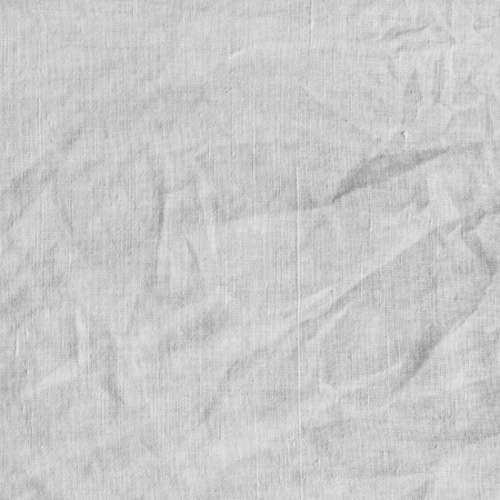 scrunch: White fabric texture. Canvas with delicate striped pattern, crumpled.