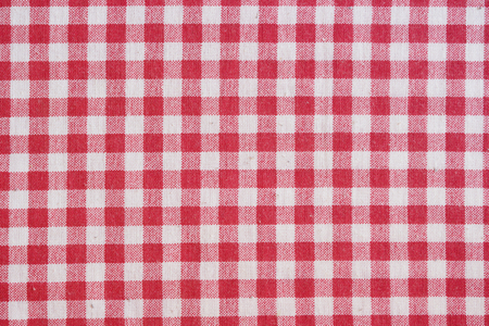 picnic tablecloth: Red picnic tablecloth background. Red and white checkered fabric texture.