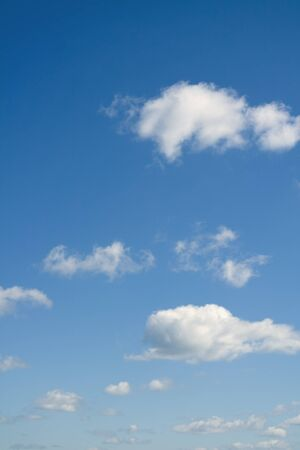 cloudscapes: Blue sky and white clouds. Cloudscape over horizon.