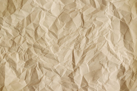 crumple: Old crumpled parchment texture. Beige paper sheet as background.