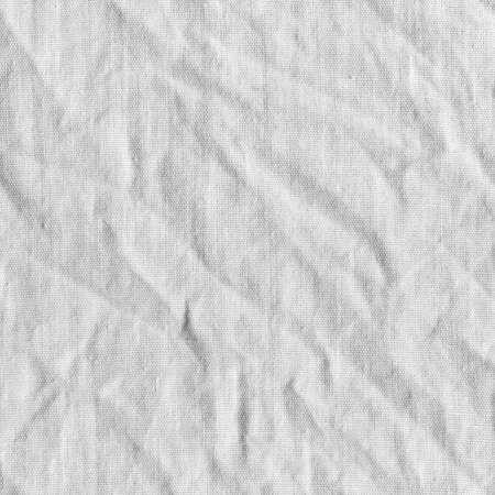 crumple: White canvas with delicate striped pattern, crumpled. Fabric texture, background.