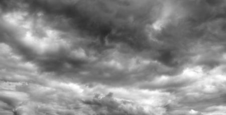 over the horizon: Thunderclouds over horizon, panorama, gray. Storm sky, rain. Stock Photo