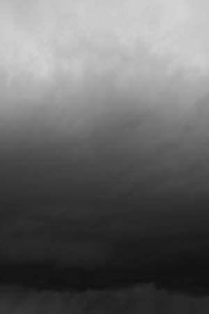 over the horizon: Storm, rain in the sky. Cloudy sky over horizon, thunderclouds. Stock Photo
