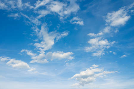 over the horizon: Cloudscape over horizon. Heaven. White clouds in the blue sky. Stock Photo
