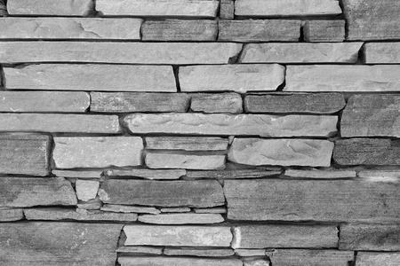 briks: Old brick wall background. Grey stone wall texture, slim briks. Stock Photo