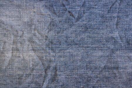 scrunch: Blue vintage denim jeans background. Jeans texture, fabric.