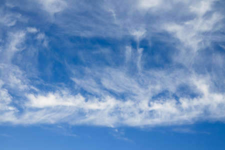 over the horizon: Blue sky and white clouds. Cloudscape over horizon.