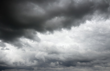 over the horizon: Storm clouds before a thunderstorm. Cloudy sky over horizon. Stock Photo
