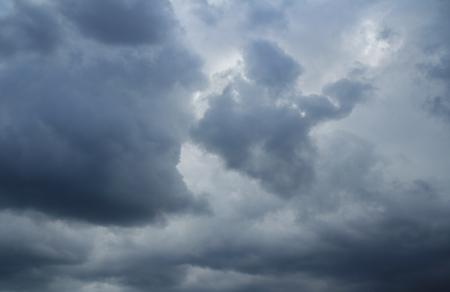 over the horizon: Dramatic thunderclouds over horizon, dark, gray. Stormy sky, rain. Stock Photo