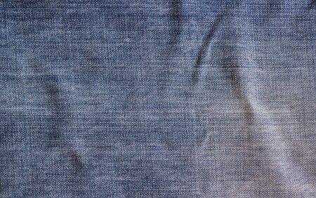 crumple: Jeans texture, fabric. Blue vintage denim jeans background. Stock Photo