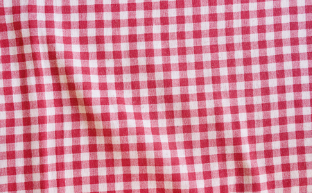 scrunch: Red crumpled picnic tablecloth background. Red and white checkered fabric texture. Stock Photo