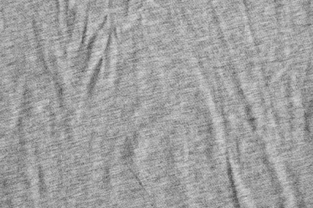 scrunch: Wool texture, crumpled, with delicate striped pattern. Gray fabric background.