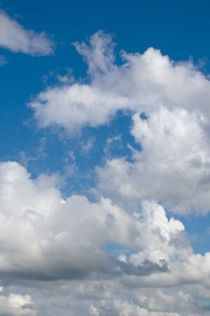 over the horizon: White clouds over horizon. Blue sky aand white clouds. Stock Photo