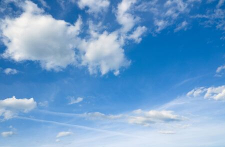 over the horizon: Beautiful cloudscape over horizon. White clouds and blue sky.