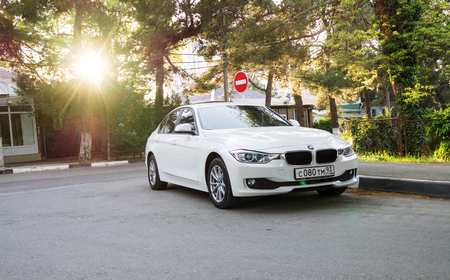bmw: SOCHI, RUSSIA - APRIL 29, 2016: BMW 525 parked on the streets of Sochi. BMW is a German automobile company founded in 1916. BMW 525 in sunlight
