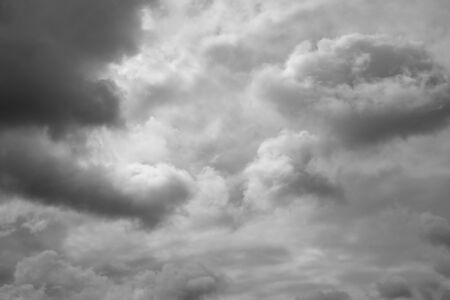over the horizon: Sunshine through storm sky, clouds. Storm clouds over horizon.