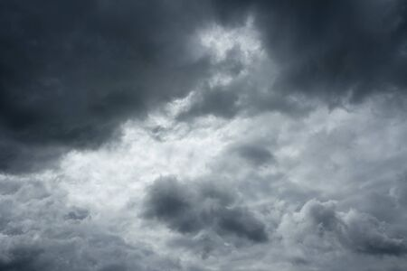 over the horizon: Clouds before a thunderstorm. Storm clouds, sky over horizon.