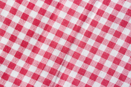 picnic tablecloth: Red and white checkered picnic tablecloth. Red picnic tablecloth background.