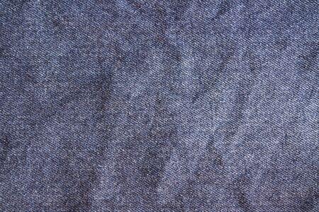 crumple: Jeans texture, fabric. Blue crumpled denim jeans background. Stock Photo