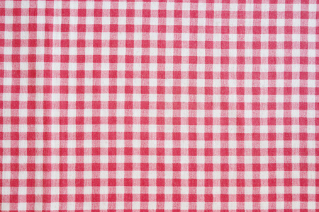 crumple: Picnic tablecloth background. Red and white checkered fabric texture.
