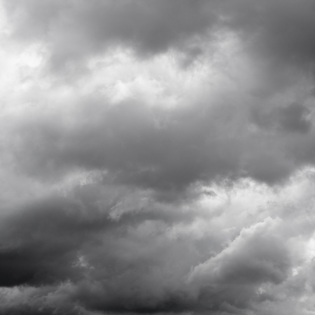 over the horizon: Moody clouds before a thunderstorm. Cloudy sky over horizon.