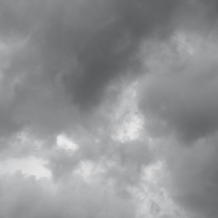 over the horizon: Gray clouds before a thunderstorm. Cloudy sky over horizon. Stock Photo