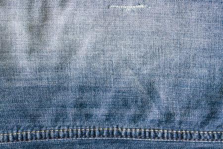 crumple: Blue vintage denim jeans texture with thread. Jeans background, crumple.