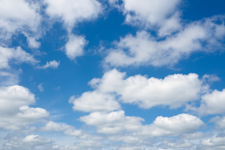 over the horizon: Clouds flying against blue sky. Blue sky and clouds over horizon. Stock Photo