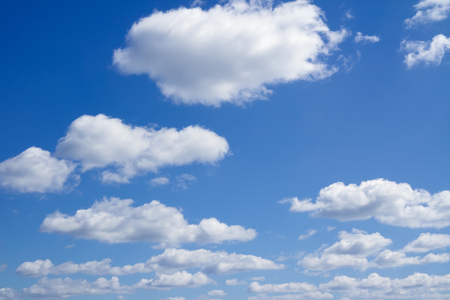 over the horizon: Sky with clouds over horizon. Clouds flying against blue sky. Stock Photo