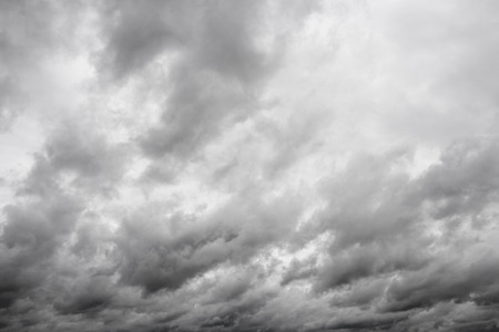over the horizon: Gray clouds over horizon, storm. Cloudy sky background.