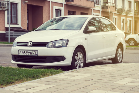 Sochi, Russia - October 11, 2016: New white Volkswagen Polo parked on the street of Sochi. Publikacyjne