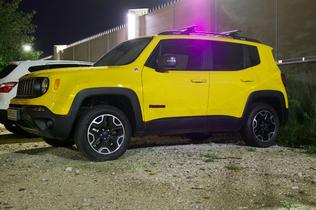 the jeep: Sochi, Russia - October 09, 2016: New shining yellow Jeep Renegade on the street of Sochi City at night.