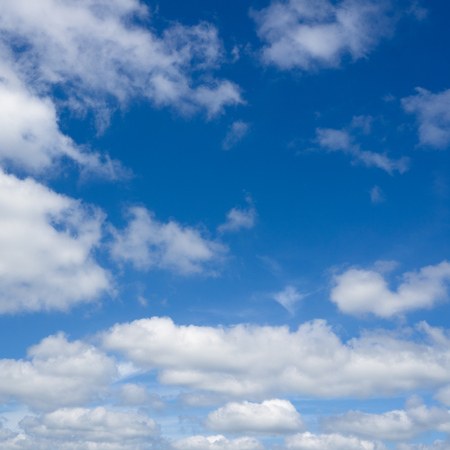 over the horizon: Clouds flying against blue sky. Sky with clouds over horizon. Stock Photo