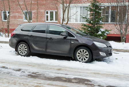 Smolensk, Russia - November 13, 2016: Opel Astra (Vauxhall Astra in USA) parked in winter near the house. Editorial