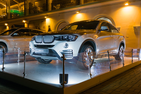Sochi, Russia - October 12, 2016: Luxury Bmw x4 at night, new model of the brand BMW near the dealers showroom.