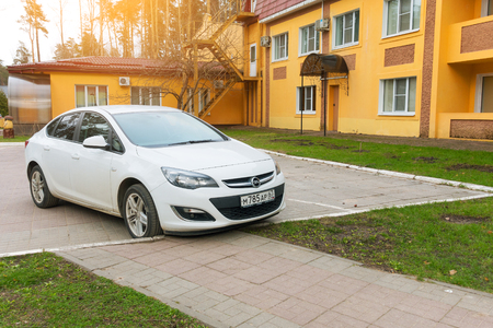 Smolensk, Russia - April 25, 2017: New Opel Astra parked near house on the street of Smolensk City. Editorial