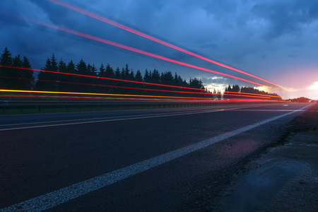 Road at night. View on highway, speed concept.