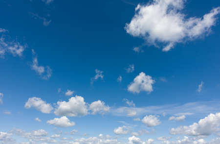 Beautiful clouds flying against blue sky at sunny day. Blue sky with clouds over horizon.