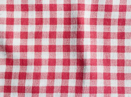 Red and white picnic tablecloth. Checkered picnic blanket. Stock Photo