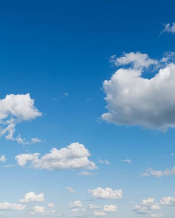 Beautiful blue sky with clouds over horizon. Clouds flying against blue sky at sunny day. Stock Photo