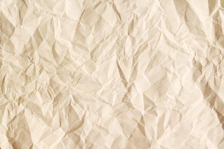 Oude verfrommelde perkamenttextuur. Beige leeftijd papier bladachtergrond.