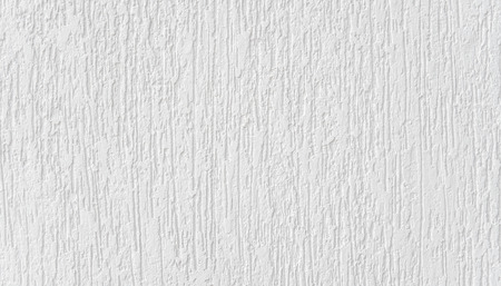 White abstract background. High detailed fragment of white painted stone wall.