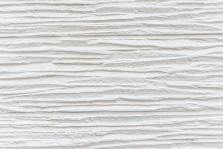 White striped background. High detailed fragment of white stone wall