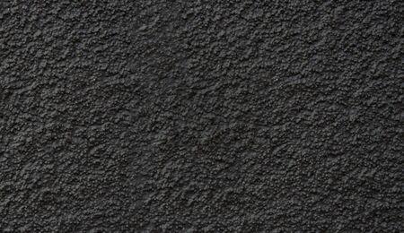 New asphalt close-up. Black background or texture