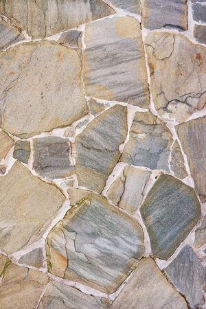 Stone wall texture. Natural cobblestone wall, high detail background. Stone road Foto de archivo