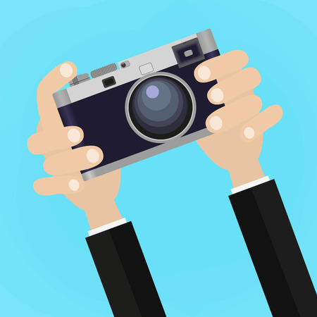 correspondent: Flat illustration of Retro photo camera with hand holding it. illustration of a hand holding Vintage camera for your design