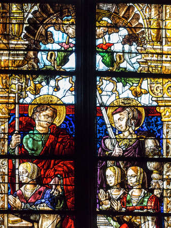 ligature: Catholic church interior stained-glass, Arlon, BelgiumCatholic church interior stained-glass, Metz, France