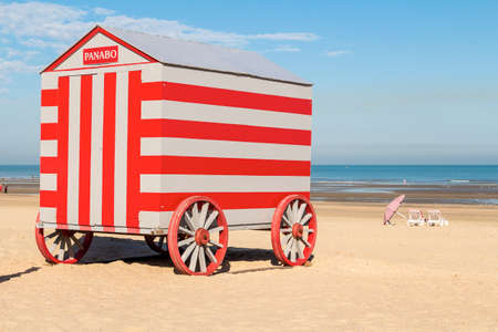 Colorfull carries changing stalls (cabana) on North sea beach, De-Panne, Belgium Stock Photo