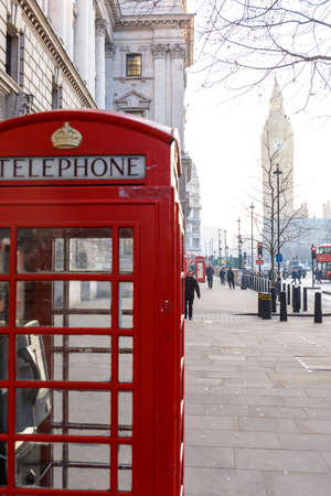 Traditional London red phone box and Big ben in early winter morning Stok Fotoğraf